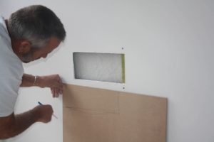 Measuring hole in plaster wall